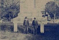 Captain Daniel Tuttle and Luke Smith in front of the Isaac Davis Monument, Acton Center (AML archives 73.6.1)